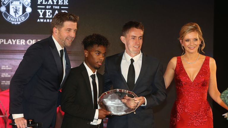 Angel Gomes is presented with the Jimmy Murphy award by U18s manager Kieran McKenna
