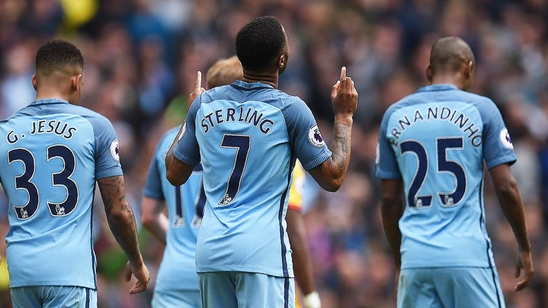 Raheem Sterling celebrates after scoring Man City's fourth