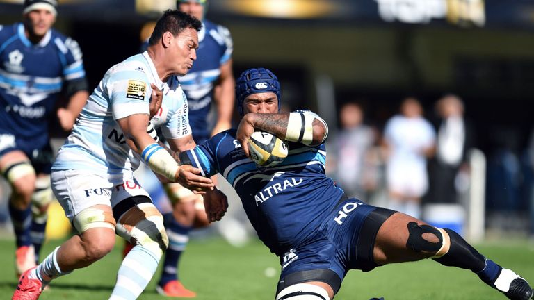 Montpellier winger Nemani Nadolo is tackled by Racing No 8 Chris Masoe
