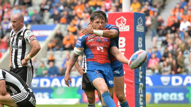 Scott Grix celebrates after scoring his first try against former club Widnes