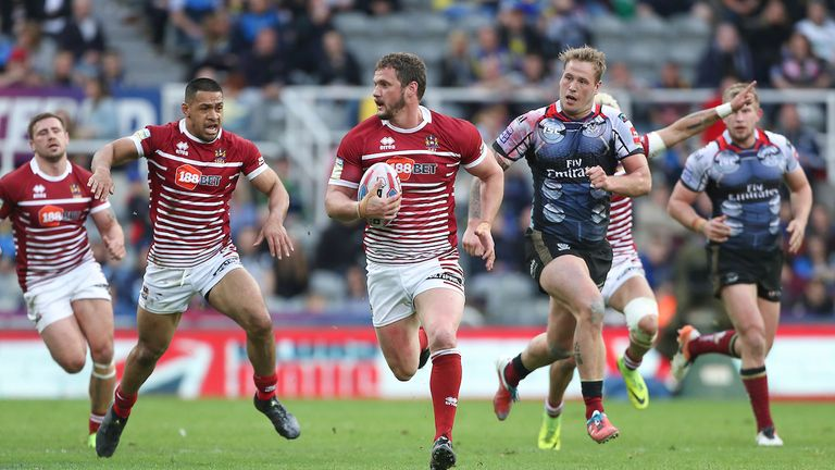 Wigan's Sean O'Loughlin breaks free from Warrington in their 2017 Magic Weekend thriller