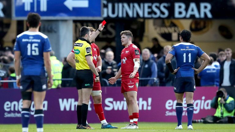 Scarlets' Steff Evans is sent off by referee Marius Mitrea after a tip-tackle on Leinster's Garry Ringrose
