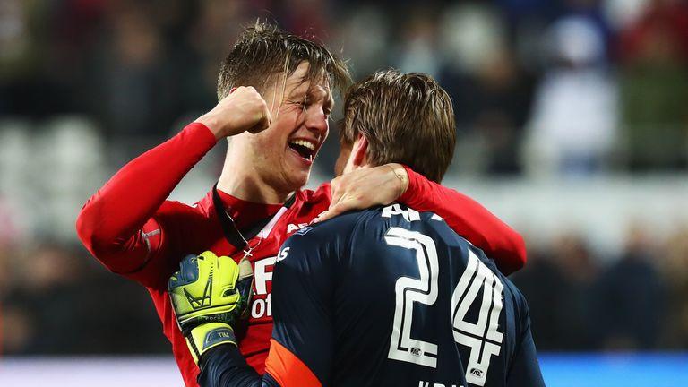 Wout Weghorst celebrates reaching the final with goalkeeper Tim Krul