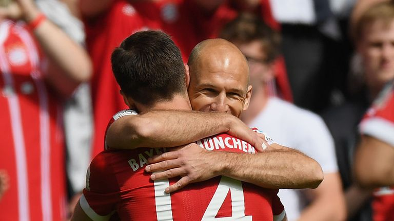 Alonso celebrates with Arjen Robben after laying on the Dutchman for Bayern's opener
