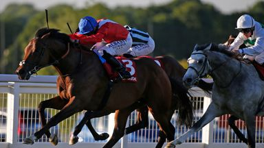Ryan Moore riding Autocratic (red) win the Matchbook Brigadier Gerard Stakes at Sandown