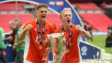 Blackpool goalscorers Brad Potts and Mark Cullen celebrate with the League Two play-off final trophy