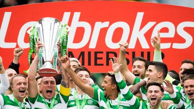 Celtic captain Scott Brown lifts the Ladbrokes Premiership trophy