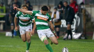 Treviso's Ian McKinley kicks at goal