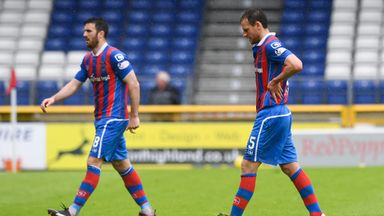 Inverness players Ross Draper and Gary Warren leave the pitch following the club's relegation