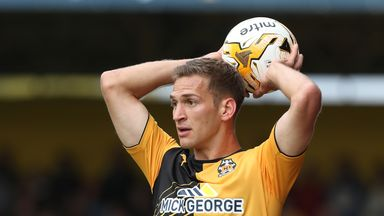 Mickey Demetriou has extended his stay with Newport