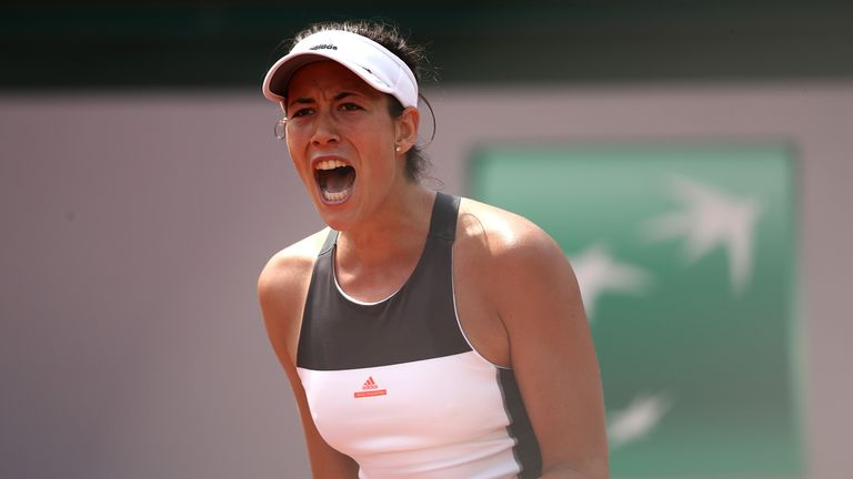 PARIS, FRANCE - MAY 29:  Garbine Muguruza of Spain celebrates winning a point during the first round match against Francesca Schiavone of Italy on day two