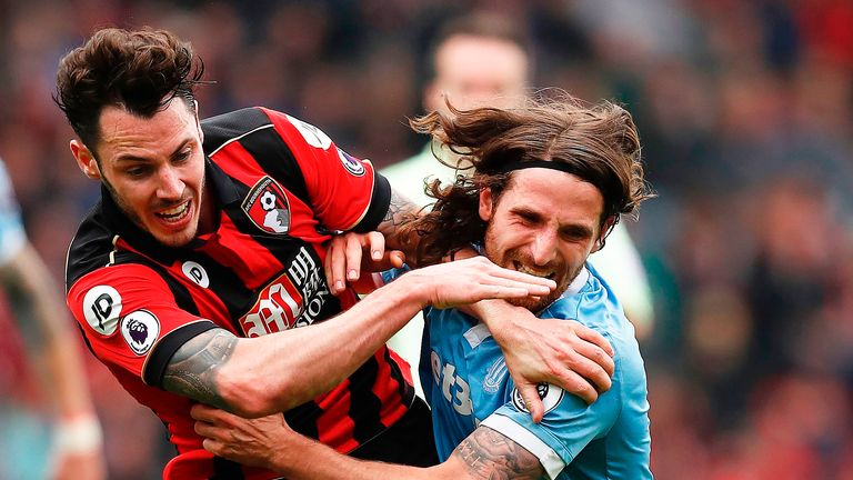 Adam Smith and Joe Allen tussle with each other at the Vitality Stadium
