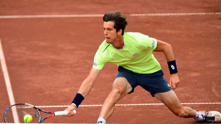 Britain's Aljaz Bedene returns the ball to France's Lucas Pouille during their final tennis match at the Hungarian Open in Budapest, on April 30, 2017. / A