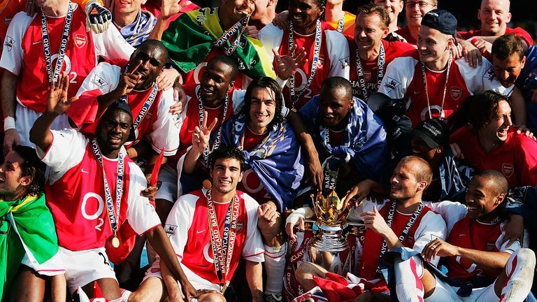 Arsenal players celebrate their unbeaten title triumph in 2003/04