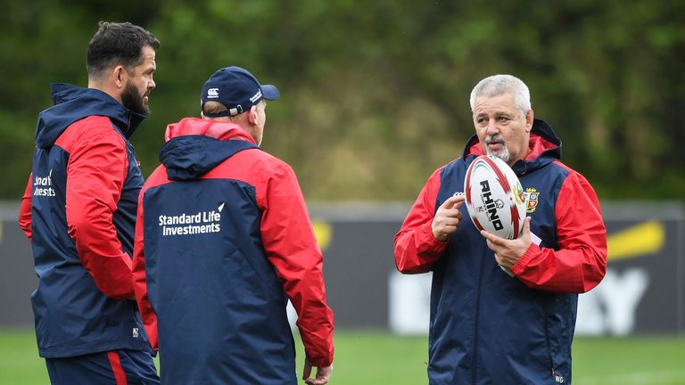 Warren Gatland in discussion with Lions coaches Andy Farrell and Neil Jenkins