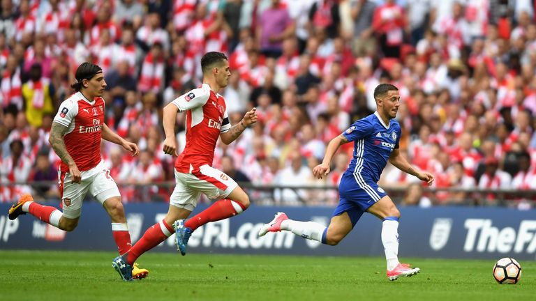 Eden Hazard of Chelsea gets away from Granit Xhaka of Arsenal during The Emirates FA Cup Final between Arsenal and Chelsea at Wembley