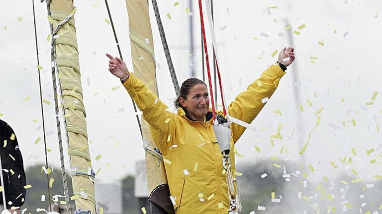 Southampton sailor Dee Caffari on the bow of her yacht Aviva, 21 May 2006, as she returns home to the city after an epic six months at sea