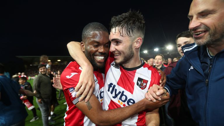 Exeter City's Jordan Moore-Taylor (right) and Joel Grant celebrate after the final whistle during the Sky Bet League Two play-off second leg at St James Pa