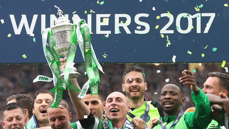 Scott Brown of Celtic lifts the trophy during the William Hill Scottish Cup Final between Celtic and Aberdeen at Hampden Park