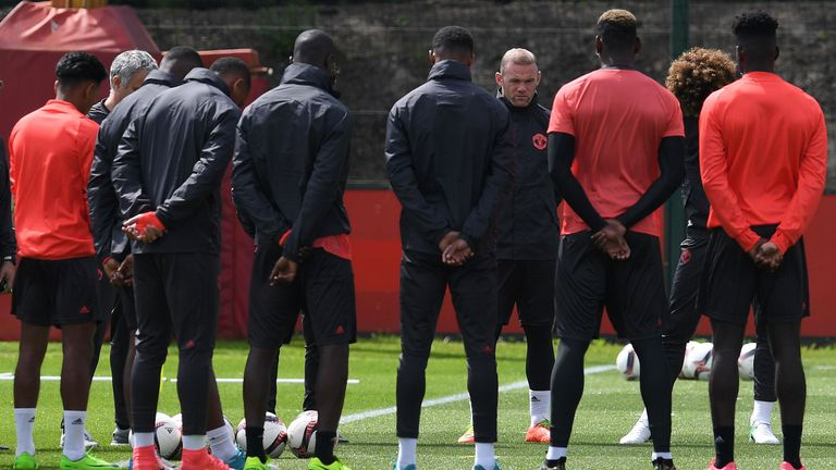 Manchester United's Wayne Rooney stands with team-mates as they observe a minute's silence for the victims of Monday's terror attack