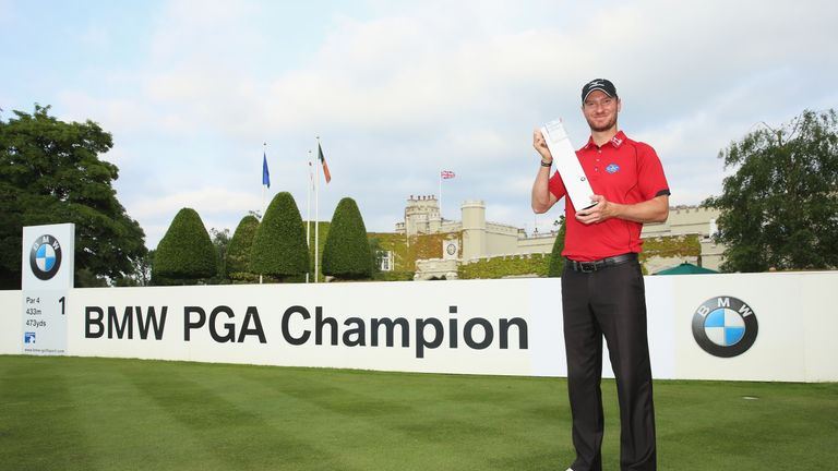 VIRGINIA WATER, ENGLAND - MAY 29:  Chris Wood of England poses with the trophy following his victory during day four of the BMW PGA Championship at Wentwor