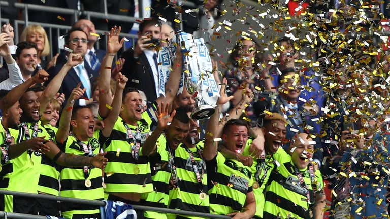 LONDON, ENGLAND - MAY 29:  Huddersield Town players celebrates promotion to the Premier League after the Sky Bet Championship play off final between Hudder