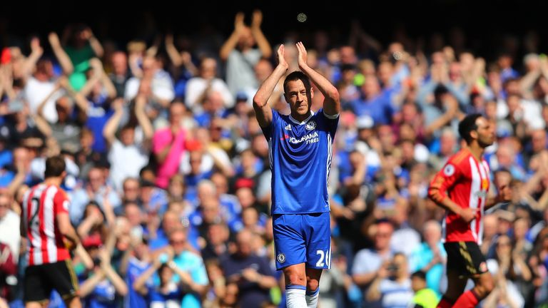 John Terry applauds fans as he leaves the pitch after picking up an injury