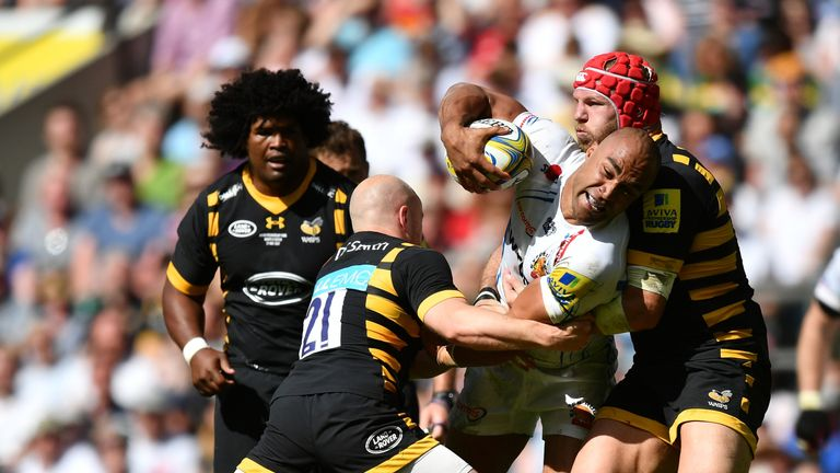 Olly Woodburn of Exeter Chiefs is tackled by Joe Simpson of Wasps during the Aviva Premiership Final