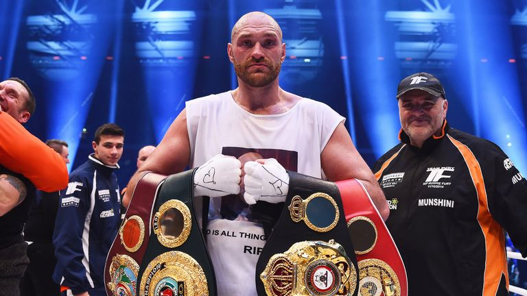 Tyson Fury celebrates after defeating Wladimir Klitschko to become World Heavyweight Champion on November 28, 2015