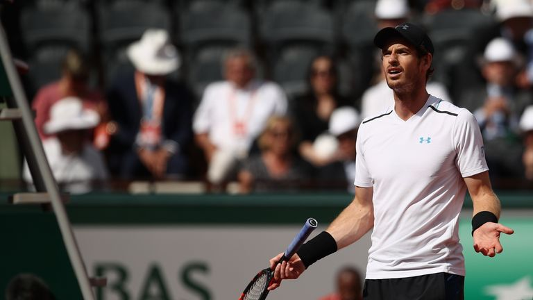 Murray protests with umpire Carlos Ramos after receiving a time penalty
