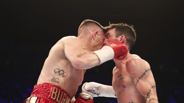 Both fighters were left with cuts after they clashed heads in the second round