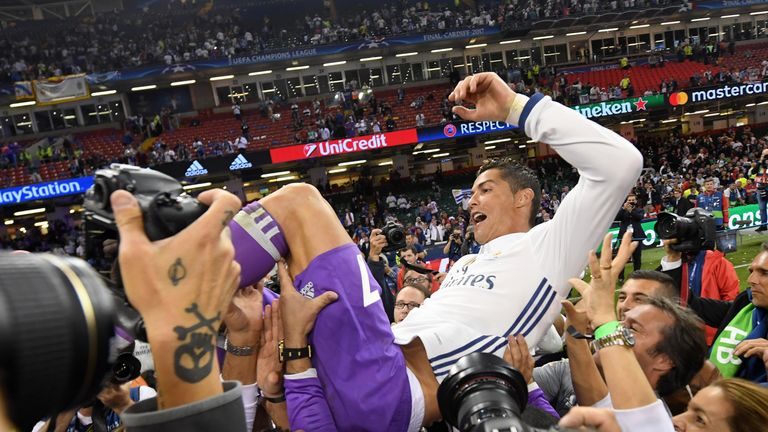 Cristiano Ronaldo is thrown into the air by his Real Madrid team-mates after Champions League final victory
