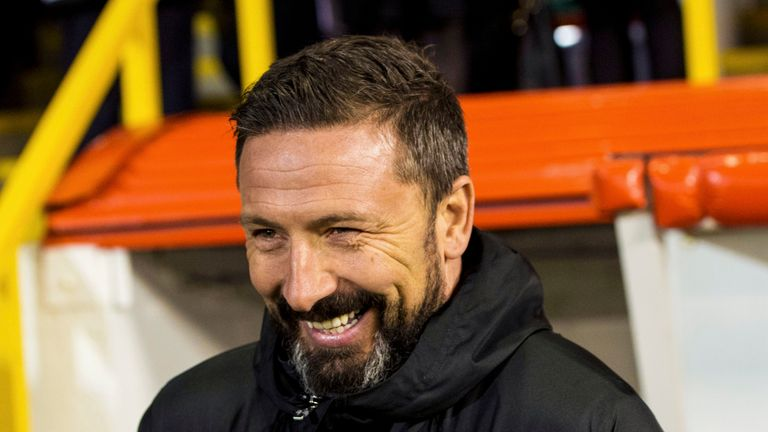 Aberdeen manager Derek McInnes has decided to stay with the Dons despite interest from Rangers