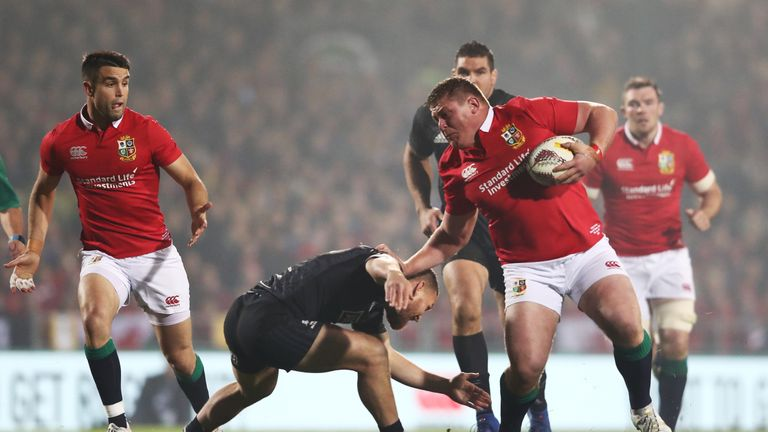 Tadhg Furlong of the Lions hands off Tawera Kerr-Barlow of the Maori All Blacks in the first half