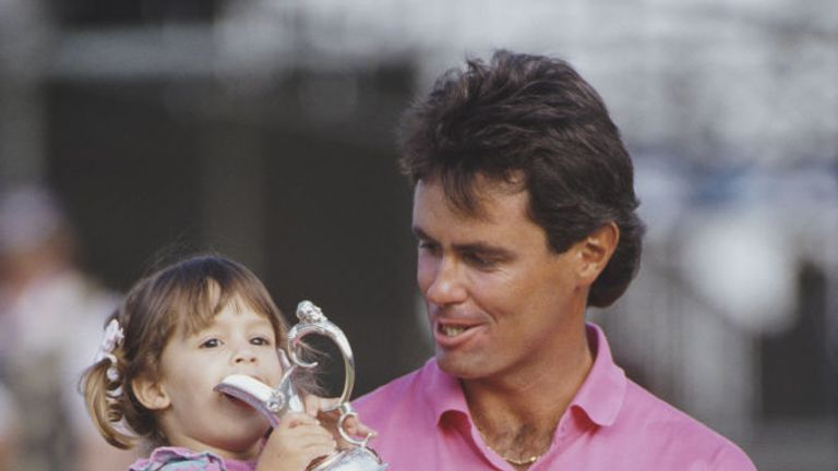 Ian Baker-Finch of Australia holds the trophy with his young daughter in 1991