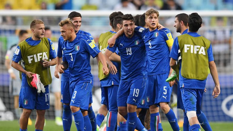 Italy's players celebrate their victory over Zambia
