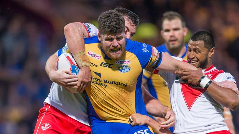 Mitch Garbutt fends off St Helens's Dominique Peyroux.