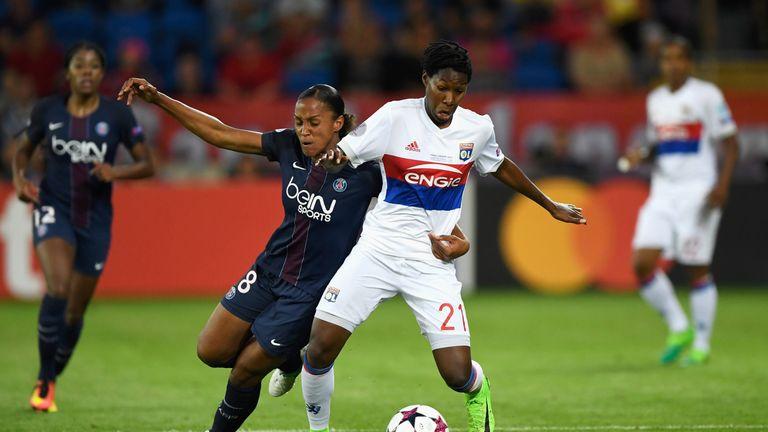 Kadeisha Buchanan and Marie-Laure Delie battle for the ball