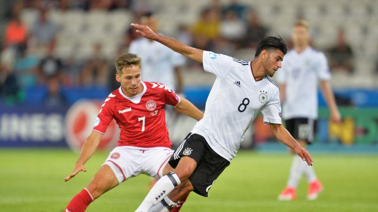 Andrew Hjulsager of Denmark puts pressure on Mahmoud Dahoud of Germany