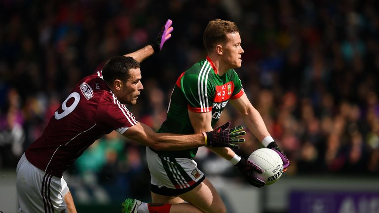 Donal Vaughan of Mayo tussles with Fiontan O'Curraoin of Galway