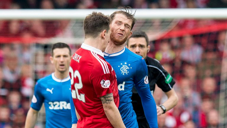 Jack (left) clashes with Joe Garner during the game between Aberdeen and Rangers at Pittodrie in April