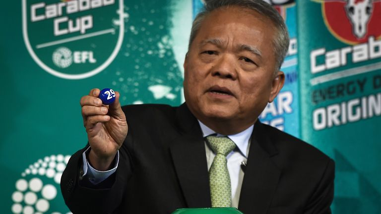 CEO of Carabao Group Sathien Setthasit draws a number during the first draw for the upcoming season's Carabao Cup