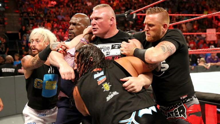 Brock Lesnar and Samoa Joe had to be held back by most of the RAW roster.