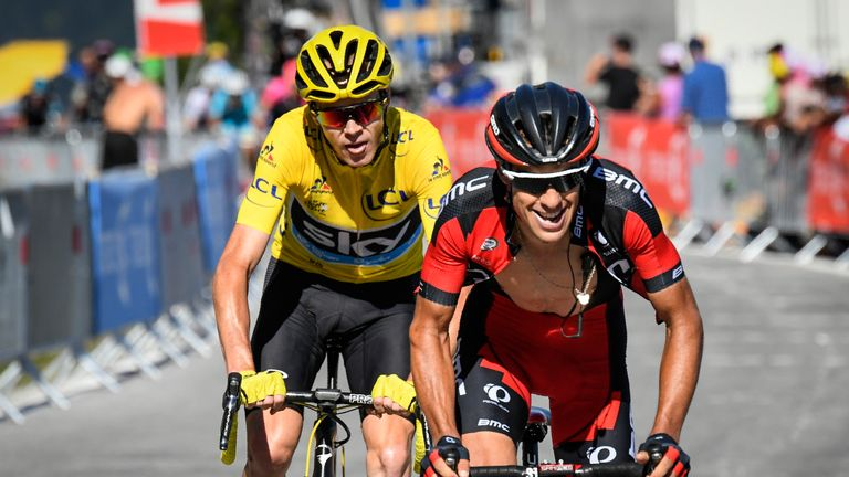 Australia's Richie Porte (R) rides ahead of Great Britain's Christopher Froome, wearing the overall leader's yellow jersey, during the 184,5 km seventeenth