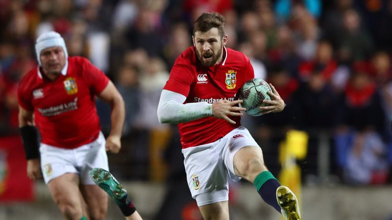 HAMILTON, NEW ZEALAND - JUNE 20:  Elliot Daly of the Lions skipsthrough the tackle from Finlay Christie of the Chiefs during the 2017 British & Irish Lions