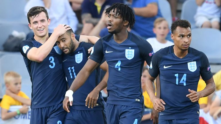 England's midfielder Nathan Redmond (2nd L) celebrates  scoring his side second goal with his teammates (L-R) Ben Chilwell, Nathaniel Chalobach, and Jacob