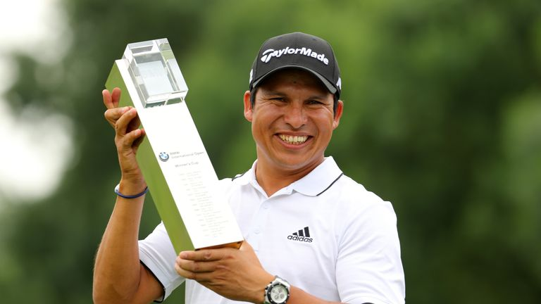 Andres Romero of Argentina poses with the trophy following his victory during the final round of the BMW International Open at