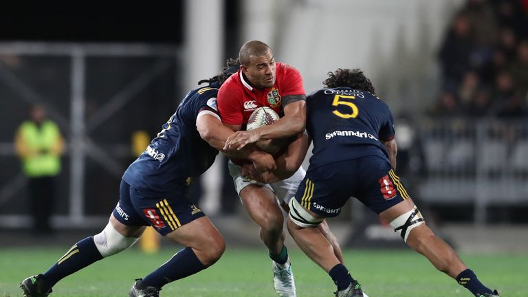 DUNEDIN, NEW ZEALAND - JUNE 13:  Jonathan Joseph of the Lions is tackled by Aki Seiuli (L) and Jack Hemopo (R) of the Highlanders during the 2017 British &