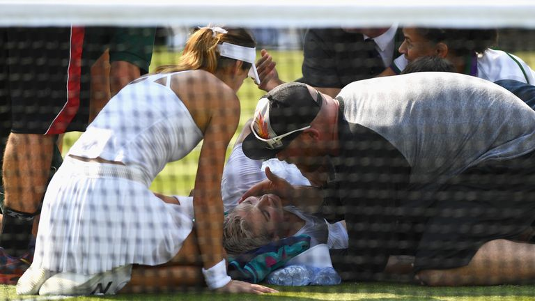 Bethanie Mattek-Sands receives treatment after her fall on Thursday
