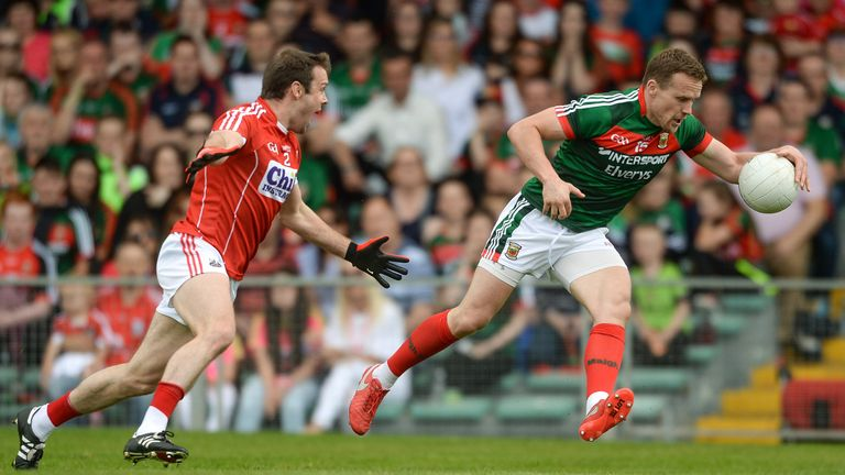 Andy Moran of Mayo gets past James Loughrey of Cork